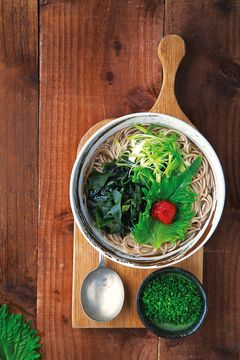 Takashi Miyazaki\'s hot soba noodle soup with ume plum, shiso and wakame seaweed