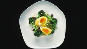 Crispy organic duck egg with purple sprouting broccoli