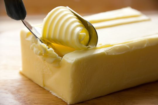 Butter shaved with knife