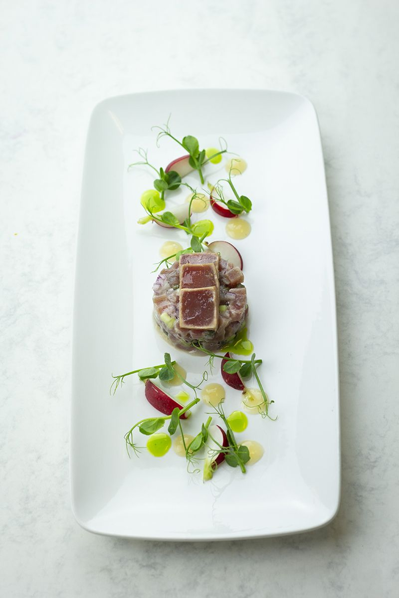 Tuna tartare  gooseberry puree  dill oil  pickled radishes and pea shoots  3