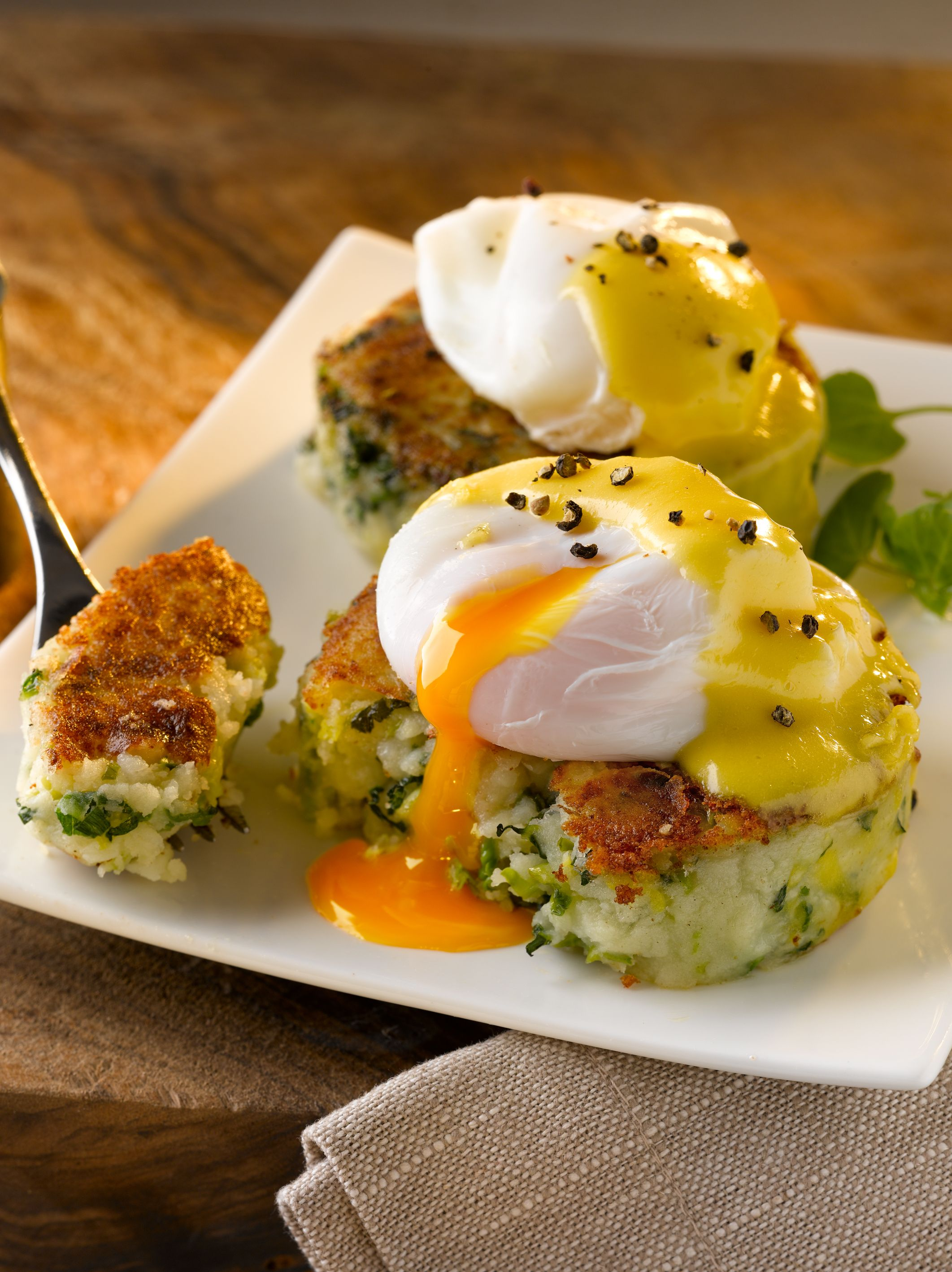 Colcannon_cakes_with_poached_eggs_and_hollandiase_sauce