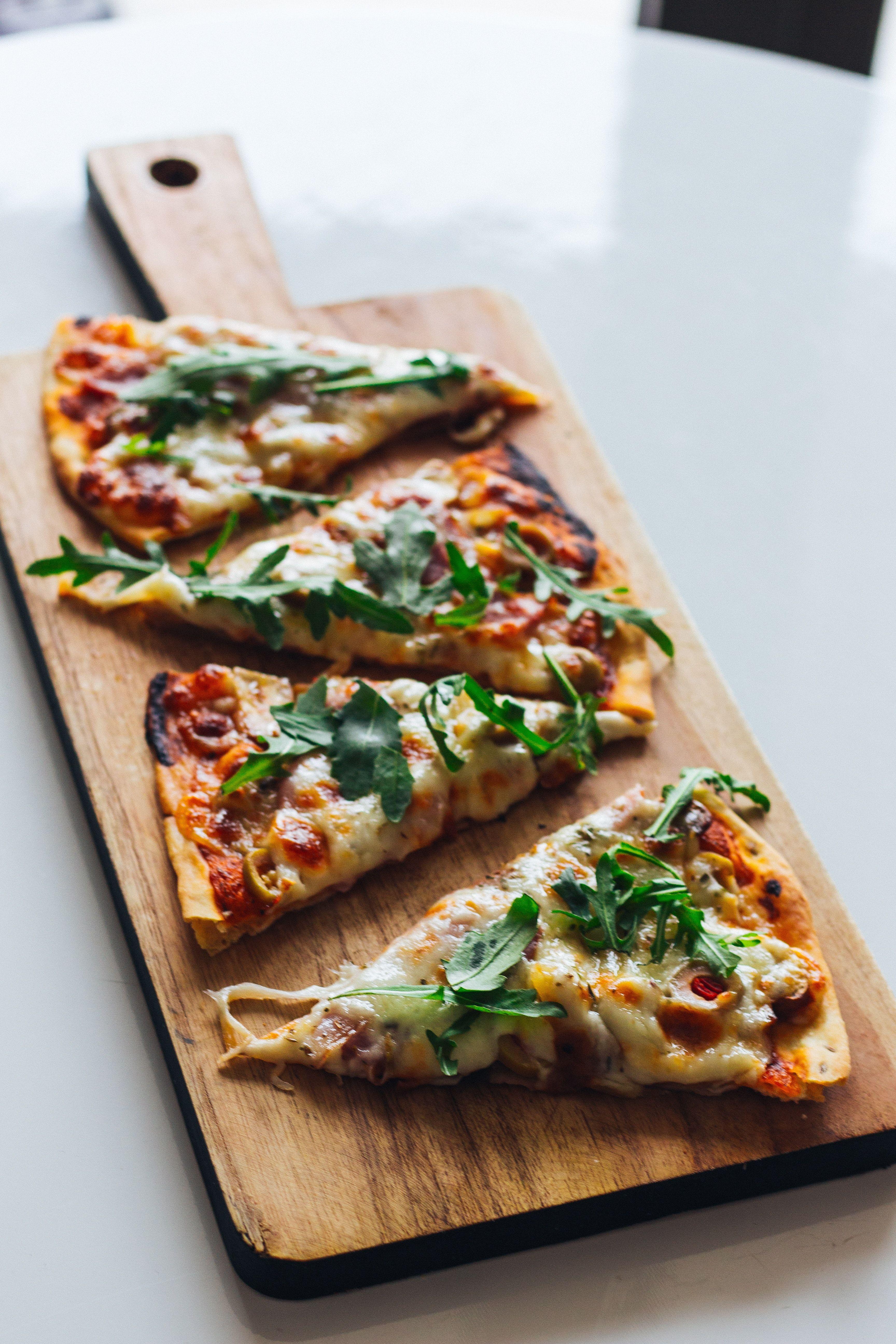 Pizza_slices_sahand-hoseini-bmvayjpf6mu-unsplash