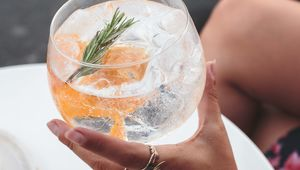 Thumb_gettyimages-1077720462_gin_in_hand