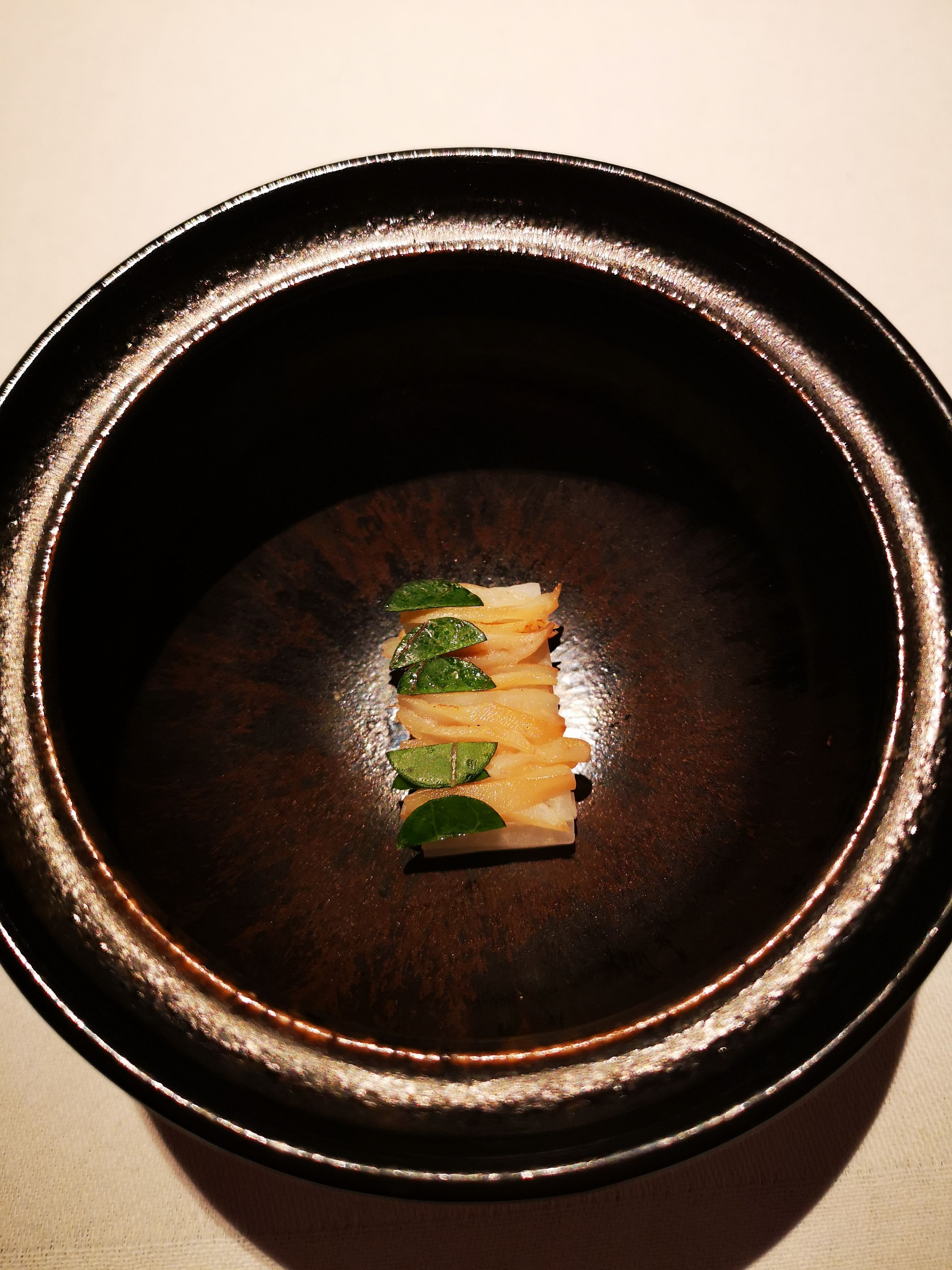 Connemara clam flash cooked over hot birch wood with fermented kohlrabi juice infused with lemon balm, smoked Newgrange rapeseed oil