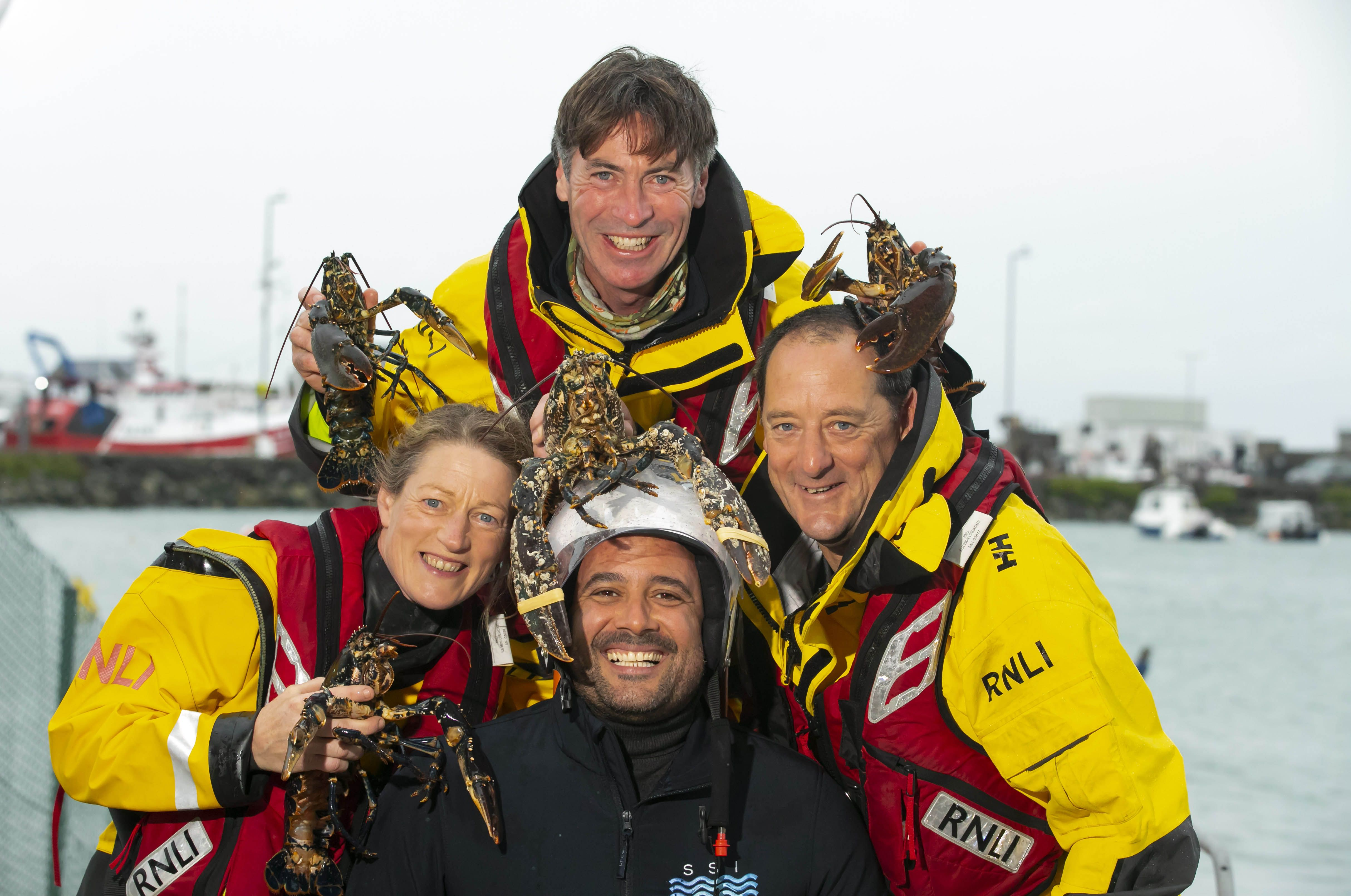 Niall Sabongi with members of the RNLI search and rescue team.