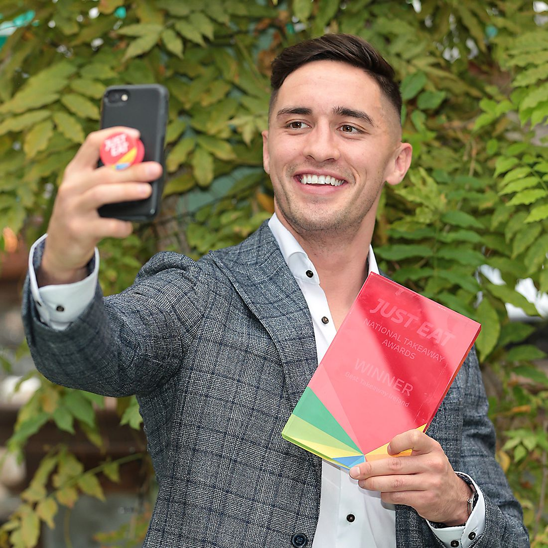 Love Island's Greg O'Shea with a Just Eat National Takeaway Awards plaque.