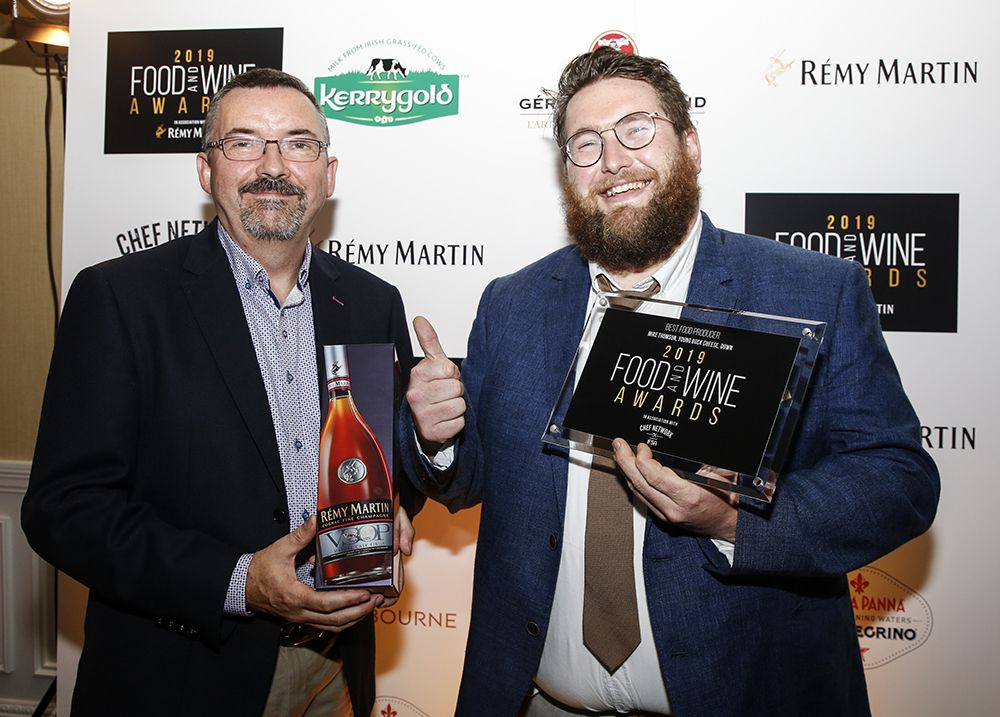 Kevin from Loose Canon accepting the award for Best Producer on behalf of Mike Thomson of Young Buck Cheese with Patrick Clement from Chef Network IFSA.