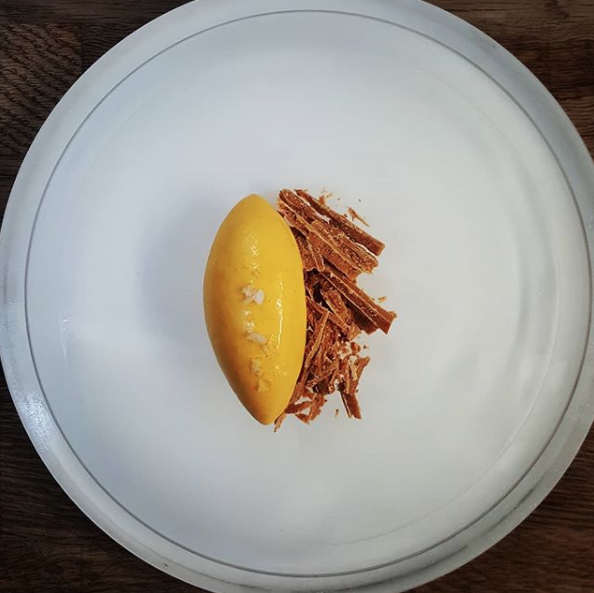 Seabuckthorn ice cream, caramelized white chocolate, seasalt from Eipic. Photo by @chefalexgreen on Instagram.