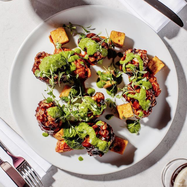 Spiced Cauliflower Ribs with Sticky BBQ Sauce, Pepper & Fennel Stew and Mojo Verde. Picture from @glasrestaurant on Instagram.