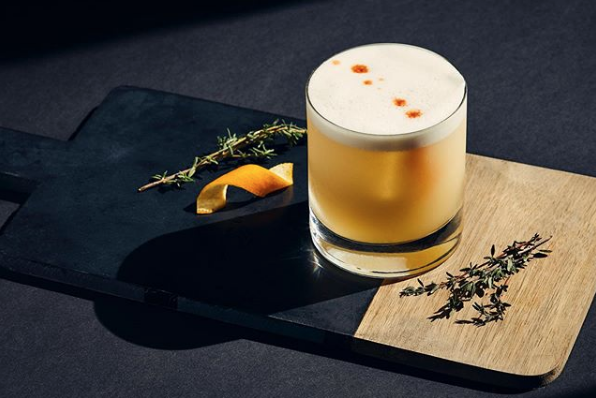 Whiskey sour image by @mooganphoto on Instagram.
